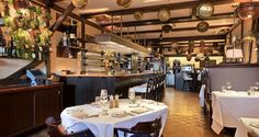 The Cape Cod Room at The Drake Hotel features fresh seafood in a cozy harbor restaurant setting.