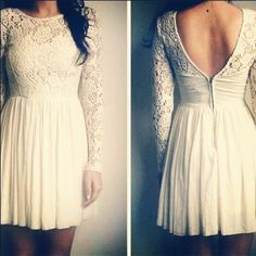 White lace long sleeved dress with a v-shape on the back and a flowy/aline skirt