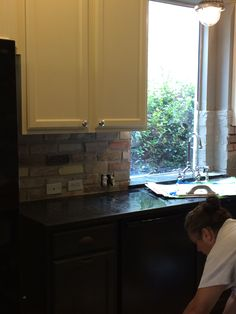Kitchen brick veneer backsplash