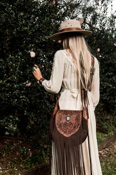 Western Floral Saddle Bag with Candelaria Turquoise. Carefully handcarved panels, dark chocolate brown suede topped off with extra long tassels <3 #buffalogirl #bags #suede #leather