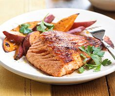 Ground ancho chile adds a delicious bite to the grilled salmon. The sweet fries make a colorful and fun side dish.