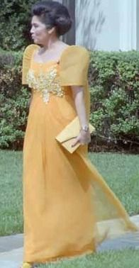 March 20 – Ferdinand Marcos's widow, Imelda Marcos, goes on trial for bribery, embezzlement, and racketeering Filipiniana Wedding, Filipiniana Dress, Ferdinand, Filipino Fashion, The Wedding Singer, Mom Dress, Retro Hairstyles, Famous Women, Yellow Dress