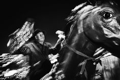 Dark Horse. A protester rides a fiberglass horse in Gwanghwamun Square to deliver his message to others. Throughout the many public demonstrations, the largest one had an estimated 1.7 million participants. © Argus Paul Estabrook. Street Series Winner, Magnum Photography Awards 2017.
