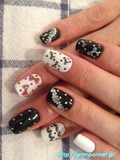 Dot and lace and ribbon in one color black and white nail paint  白と黒の一色塗りネイルにリボンやドットやレース