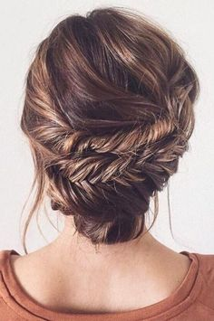 04 a wavy low fishtail braid updo with some bangs - Styleoholic