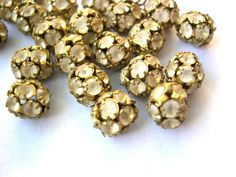 2 Vintage Swarovski beads 8mm white shade crystals in brass setting creating ball bead. $3.00, via Etsy.