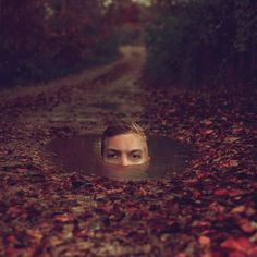 Kyle Thompson, Chicago born photographer has created these amazing and surreal self portraits. He often photographs in empty forests and abandoned homes.