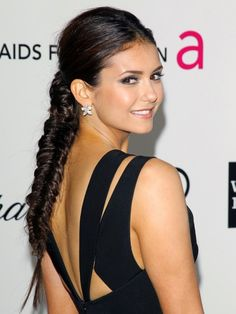 Nina Dobrev starts with a center part and then works her length into an extra-thick fishtail braid.