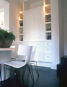 Treating the floor plane as ebonized wood, and by using white as the dominant color in wall, millwork and ceiling planes, enhance the effect of expansiveness and simplicity of the interiors overall. Urban Loft, Shaker Cabinets, Interior Decorating, Interior Design, Design Firms, Built Ins, Home Office, Nathan Hale, Sweet Home