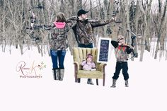 Family with hunting gear in the winter