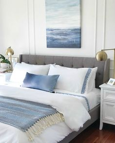 Blue and white calming bedroom with coastal style - decorating with blue and white for Spring - Jane at Home - #homedecor #bedroomideas #bedroomdecor