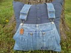 Memory pillow sewn from overalls and a shirt.  The personalized leather tag adds the perfect touch to this family keepsake.