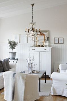 Scandinavian white sitting area in a living room.