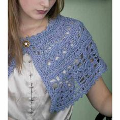 This small crochet shawl pattern begins with a simple crochet chain, forming the neck edge. Adding some fun and unusual crochet stitches in bands give the lace shawl a graceful form. Free shawl pattern.