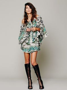 Lotta Stensson Peacock Ruffle Dress by Lotta Stensson. Loving the lace up knee high shoes too!