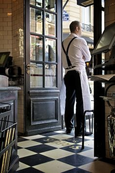Paris. Waiters often wear long white aprons.                                                                                                                                                      More