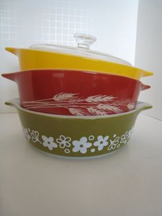 Set of Three Vintage Pyrex dishes with One Lid by SauceForThe Goose on Etsy.
