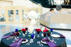 Love the tablescape in blue, purple & red from A Glamorous 1920s Art Deco Inspired Wedding Shoot at the Marine Corps Museum in Virginia