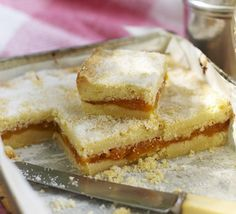 Give homemade biscuits a fruity spin by sandwiching a layer of apricots in between two layers of buttery tray-baked shortbread