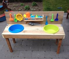 Table for kids to play with sand or water. Cute!