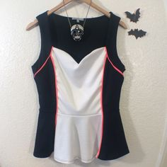 Cute Black and White top Please feel free to ask any questions..  necklace not included. Charlotte Russe Tops Blouses
