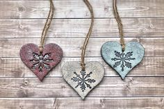 ❥ Set of 3 handcrafted polymer clay snowflake heart ornaments, designed with olde time country charm. ❥ Rustic snowflake impression hand pressed into the clay of each ornament with a rugged texture to create timeworn appeal. ❥ Hand painted detail in barn red, antique white, and mint green with a Clay Christmas Decorations, Polymer Clay Christmas, Christmas Ornament Sets, Heart Ornament, Christmas Crafts, Polymer Clay Ornaments, Ornament Crafts, Xmas Ornaments, Christmas 2017