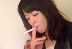 Sweet Japanese girl smoking 42