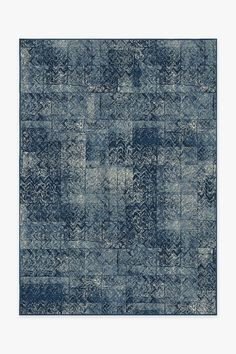 Herringbone Batik Ocean Blue Washable Rug | This design features gorgeous shades of blue with natural and creamy hues that will definitely make a strong, creative statement in any modern, contemporary or Bohemian-inspired space. #washablrug #distressedrug