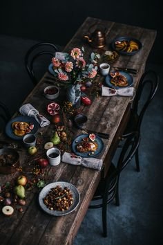 Love the moody colours with the bright pops of colours from the food and flowers