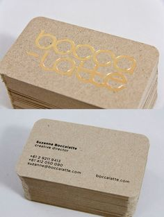 Box Board Business Card  We are obsessed with the idea of tactility in design, so we thought our business card should reflect this passion. We chose to use a gold foil stamp on the front, black foil stamp on the back on a box board stock to produce a card which has a sturdy feel with contrasting textures.