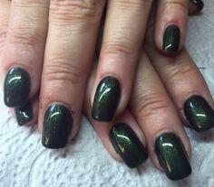 Refill acrylic with new emerald glitter gel polish.