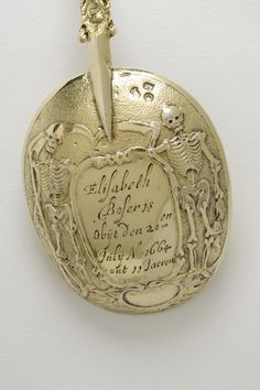 A silver-gilt funeral spoon made in Amsterdam, 1664/65; two scythe-bearing skeletons on the reverse of the bowl symbolise death. (The Holburne Museum)