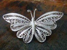Filigree Filigree is a type of art by creating intricate and detailed jewelry pieces using metal threads, such as silver and gold. Filigree Jewelry, Filigree Earrings, Silver Filigree, Metal Jewelry, Silver Jewelry, Paper Quilling Designs, Quilling Art, Big Jewelry, Jewelery
