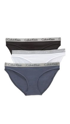Beige, white, gray, black Calvin klein underwear swimsuit for woman Calvin Klein Underwear briefs in an assortment of neutral hues. Logo lettering at waistband. Set of 3. 95% cotton/5% spandex. Wash cold. Imported, Sri Lanka. Size & Fit. Available sizes: L,M,S #trisuit