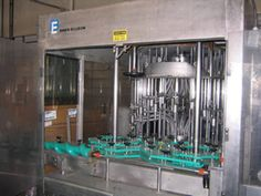 """1-USED BINER ELLISON 18 HEAD SS ROTARY LIQUID FILLING MACHINE. EQUIPPED WITH APPROXIMATELY 8.5"""" CENTERS. MACHINE COMES EQUIPPED WITH MISC. SETS OF CHANGE PARTS."""