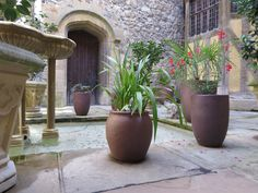 "Tinaja and Reus large Ironstone Garden Planters inside the 'Inner Courtyard"" at Leeds Castle, Kent supplied by Riverhill Garden Supplies Garden Troughs, Garden Urns, Garden Planters, Planter Pots, Garden Landscape Design, Garden Landscaping, Large Terracotta Pots, Large Garden Pots, Square Planters"