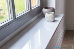 Een mooie composiet witte vensterbank die op maat gemaakt kan worden!