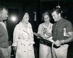 Marilyn with Allan 'Whitey' Snyder, at left, on the set of Let's Make Love, 1960.