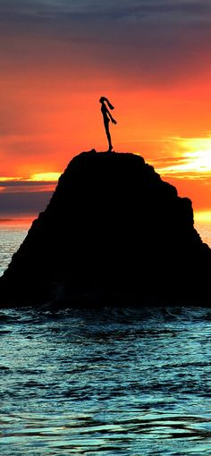 Lady on the Rock in Whakatane -  Sunset at the Whakatane Heads with the statue of Wairaka in the foreground - Bay Of Plenty, NZ
