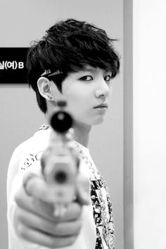 jungkook BTS.... I would die if he just looked at me like that... He wouldn't have to shoot me!