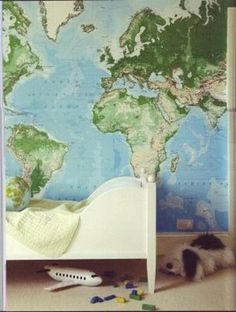 if we have a boy, his room will definitely have a travel theme...complete with map and the amazing alligator suitcases from my great-uncle Bryan's mother.