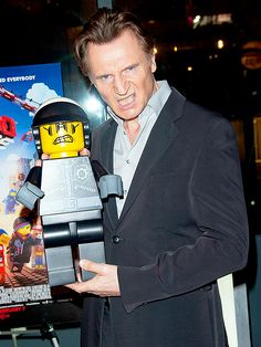 """Liam Neeson and his LEGO self: A grimacing Liam Neeson hams it up during a screening of """"The LEGO Movie"""" at AMC Empire 25 in New York City. The Northern Irishman provided the voice of the Bad Cop/Good Cop, the movie's tough guy villain with a split personality."""