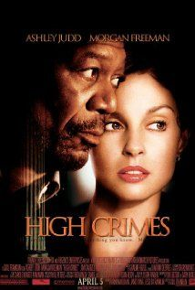 High Crimes:  High powered lawyer Claire Kubik finds her world turned upside down when her husband, who she thought was Tom Kubik, is arrested and is revealed to be Ron Chapman. Chapman is on trial for a murder of Latin American villagers while he was in the Marines. Claire soon learns that to navigate the military justice system, she'll need help from the somewhat unconventional Charlie Grimes.   (2002)