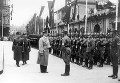 Innsbruck, Austria, March 1939, Hitler reviewing a parade of the German police.