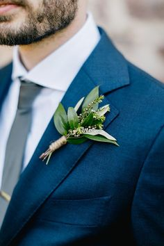 green boutonniere - http://ruffledblog.com/lush-green-wedding-with-a-boho-twist