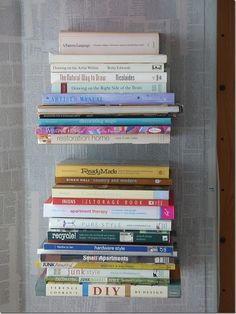 DIY: invisible bookshelf without ruining a book-YES!!!    This might be just what I need to get my to-read stacks off the floor!