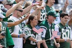 New York Jets fans wave American flags before a game against the Cincinnati Bengals at MetLife Stadium on Sept. 11, 2016.