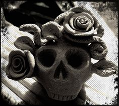 Skull, snake, rose clay mini sculpture I made then photographed with effects added