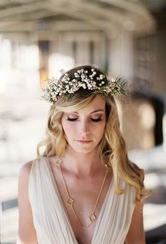 A Flower Crown with White Berries. This flower crown designed by Beehive Events forgoes basic blooms for delicate white berries. We love it for a winter wedding when your favorite flowers may be less accessible (and therefore pricier!).