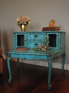 aqua french provincial  I already have this exact piece of furniture! I just need to redo it. :) joe got this exact end table for me because he knows how I adore antique's. It's current condition could be called a hot old mess but he saw the potential & so do I :)